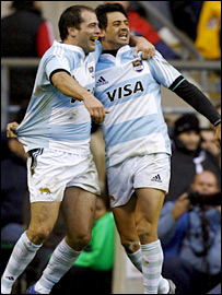 Argentina's Federico Todeschini (right) celebrates his crucial try