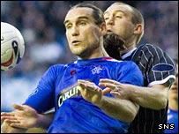 Dado Prso holds off Dunfermline's Jim Hamilton