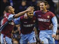 Chris Sutton celebrates his goal for Aston Villa at Everton