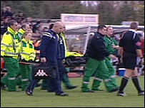 Alan Sheffield is carried from the field on a stretcher