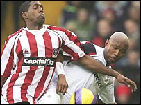 Mikele Leigertwood and El-Hadji Diouf