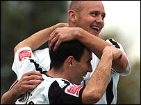 Goal-scorers Leon Britton and Lee Trundle celebrate Swansea's win