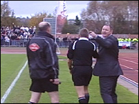 Peter Beadle remonstrates with Alan Sheffield (L) after being sent off