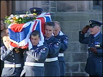 RAF crew carrying coffin