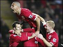 Rio Ferdinand leads the Man Utd celebrations at Blackburn