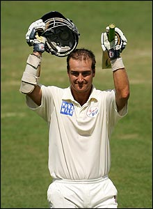 Phil Jaques celebrates his century against England