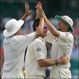 Alastair Cook and Steve Harmison celebrate the wicket of Phil Jaques with Ashley Giles