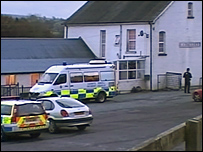 Police vehicles at the High Mead Arms
