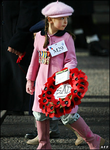 Girl carrying a poppy wreath