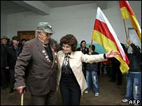 World War II veteran dances with woman in polling station in Tskhinvali