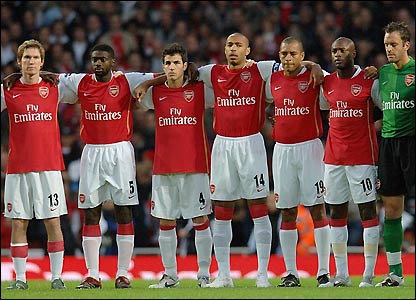 Arsenal's players observe a minute's silence