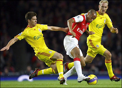Thierry Henry takes on Xabi Alonso and Sami Hyypia