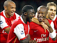 Kolo Toure (second from left) celebrates his goal with his Arsenal team-mates