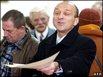 Former prime minister and mayoral candidate Kazimierz Marcinkiewicz casts his ballot