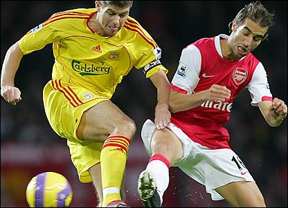 Steven Gerrard is challenged by Mathieu Flamini