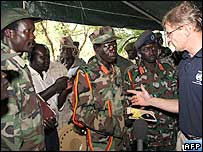 Joseph Kony (left) talks with Jan Egeland (r), with LRA commanders in background