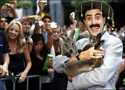 British comedian Sacha Baron Cohen holding wallaby