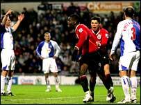 Louis Saha celebrates scoring against Blackburn with Cristiano Ronaldo