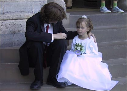 Tired flower girl Anwen Roberts with her brother Aled on the steps of Cardiff Castle (Ceredig Roberts, from Boise, Idaho)
