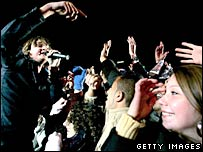 Tom Chaplin of Keane (left) performs to fans
