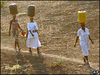 Women carry water for domestic use from the Limpopo river (AP)