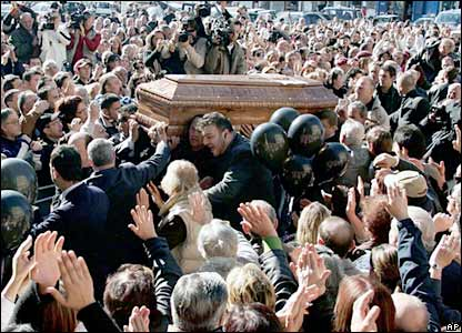Mario Merola's coffin is carried to the  Chiesa Del Carmine church in Naples, Italy