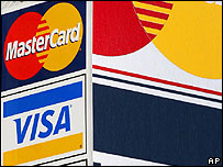 Visa and Mastercard signs on a New York advertising board