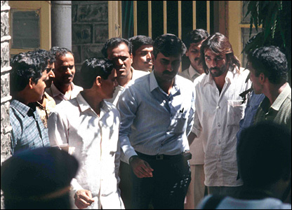 Sanjay Dutt (second from right in a white shirt) being taken to the court from the police station.