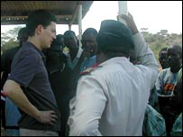 David Miliband (left) talking to villagers (Image: BBC)