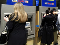 People using a cash machine