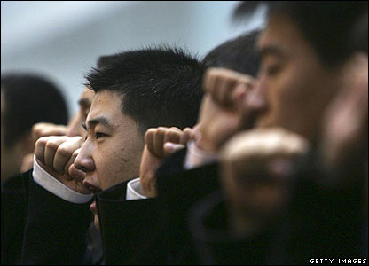Plain clothes policemen pledge to crack down on crime at a ceremony at Beijing's People's Police College on 17 October 2006