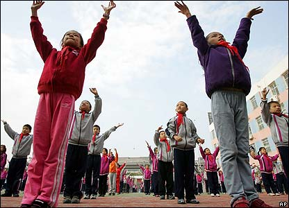 Children exercise at Huajiadi Experimental Primary School in Beijing on 25 October 2006