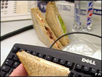 An office desk with sandwiches