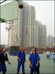Students playing basketball in the school grounds