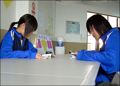 Students at work in the library of the Beijing academy