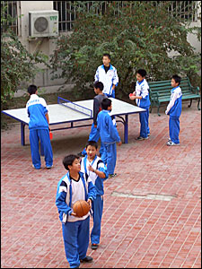 Table tennis and recreation time for children in the school courtyard