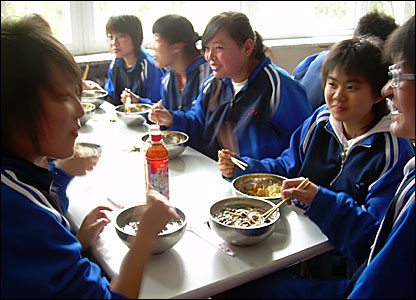 Pupils eating lunch in the school canteen