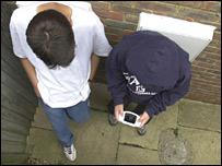 Teenage boys playing computer game