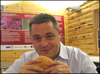 Brendon Williams tries a bacon bap