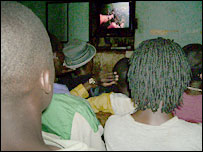 Kenyans watch a film in an unlicensed video shop
