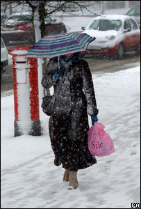 Woman walking in snow (Image: PA)