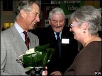 Presentation of a potted plant at visit to the Taste of Enterprise centre in Newport