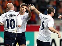 Rooney celebrates with England team-mates Johnson and Gerrard