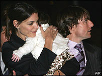 Katie Holmes and Tom Cruise, believed to be holding their daughter Suri, in Rome