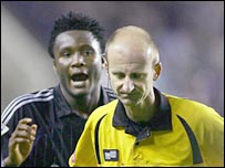 Mikel Jon Obi questions referee Mike Riley about his dismissal at Reading