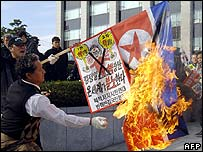 South Korean protester burns a North Korean flag at a rally in Seoul on 16 November 2006