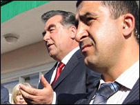 Tajikistan President Emomali Rahmonov, flanked by a bodyguard