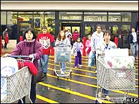 US shoppers walking out from a supermarket