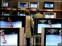 People shop for a television set