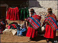 Bolivian Aymara women shop in the streets of of Penas, some 47 kilometers (29 miles) west of La Paz